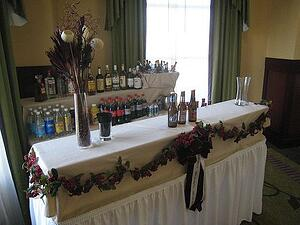setting up liquor bottles behind a banquet bar