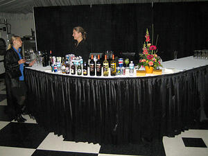 banquet bartender serving a customer