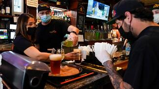 bartenders and servers wearing a mask during the COVID-19 pandemic