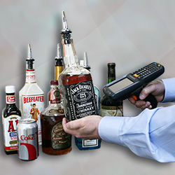 man scanning the barcode of a Jack Daniels bottle while setting up a bar inventory system