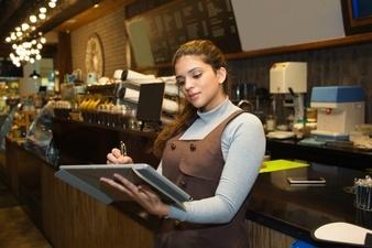 bartender writing in a shift log
