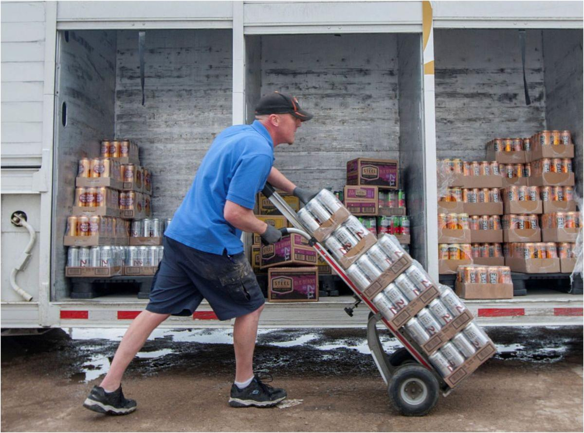 man delivering beer to a bar