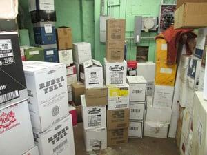 cases of liquor in a bar storeroom