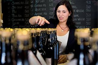 bar manager counting liquor inventory