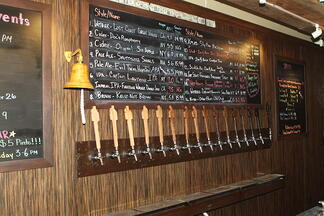 craft beer taps and menu showing the bar's current draft beer product rotation