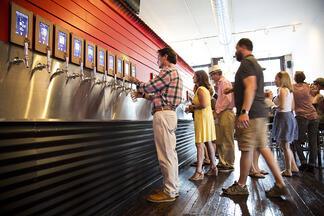 customers pouring their own beer at an iPourit self serve draft beer system