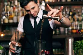 pouring liquor with a jigger