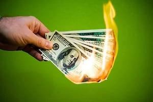 burning money symbolizing lost profits due to bar inventory shrinkage