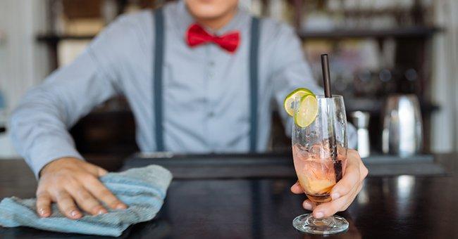 bartender spilling a drink